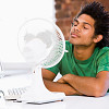 A man survives hot weather by cooling himself with a fan. (Photo: monkeybusinessimages/istockphoto.com)