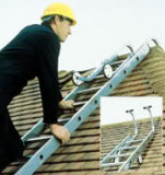 Repairman on the roofing ladder