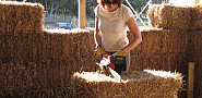 An electric chainsaw in action in the construction of a strawbale home. Photo: Brett and Sur Colstock/Flickr