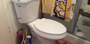 Raised-seat toilet installation