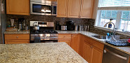 Backsplash installation matches new counters
