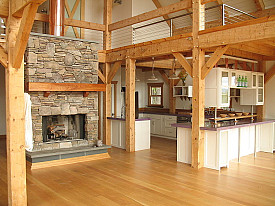 A post and beam kitchen with a purple counter top. Photo: Vermont Timber Works via Wikimedia Commons.