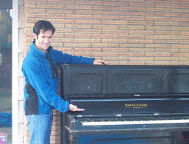 This is the author, with the piano that he is now storing on his back porch.