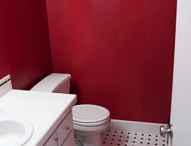 DIY striped bathroom walls in shades of red. Photo by Sayward Rebhal.
