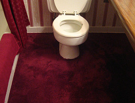The carpeted bathroom and the dense floral wallpaper need to go. (Photo: rick/Flickr creative commons)