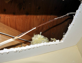 This drywall had to be cut to access electrical wires. Photo by Kevin Stevens.