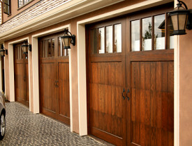 An Intro to Barn-Style Garage Doors - Networx on barn door closers, barn door type doors, dutch door garage doors, barn door flooring, screen door garage doors, barn door designs, barn door sheds, barn door canopies, barn door entertainment, barn doors as headboards, barn door shelving, barn door screen door, barn door mirrors, barn door overhead door, barn door insulation, barn door advertising, electric barn doors, barn door awnings, sliding barn doors, barn door fences,