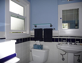 This is a lovely, simple finished bathroom remodel. We like the shade of this blue bathroom. (Photo: lavenderstreak/Flickr)