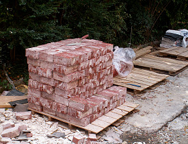 These are cleaned, salvaged bricks. Bricks are a great material to salvage for future use.