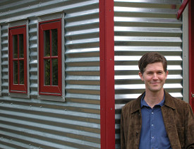 Jay Shafer in front of one of his designs. Photo by Janine Borgenson. Used with permission from Tumbleweed Tiny House Company.