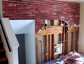 I stripped away the Z-BRICK and drywall and installed new drywall in this house. (Photo by the author, Kevin Stevens).