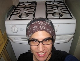 Here is a charming self-portrait taken in front of my freshly cleaned range, right after I cleaned it with toothpaste.