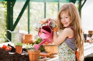 Girl in backyard greenhouse