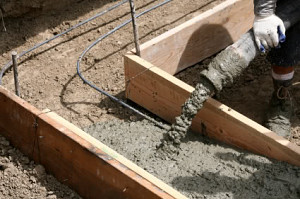 concrete pouring into footer
