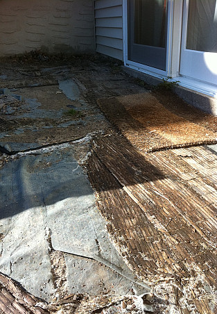 This is the patio now: bamboo mats are covering landscaping plastic and sand.