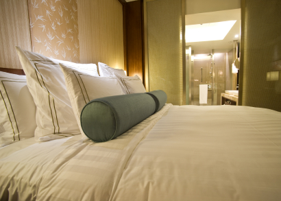 Photo of hotel bed by ymgerman/istockphoto.com.