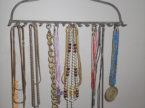 Rake head necklace rack by Lee Anne Culpepper.