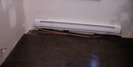 Newly installed electric baseboard heater Andrew Lin / flickr