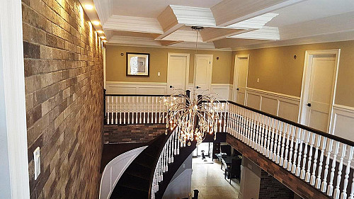 Coffered ceiling crowns a staircase by ceilingstucco/morgueFile
