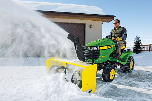 Lawn tractor blowing snow/courtesy of John Deere