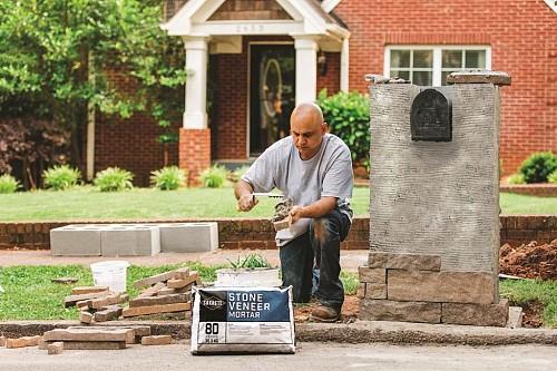 Stone veneer mortaring/courtesy Sakrete