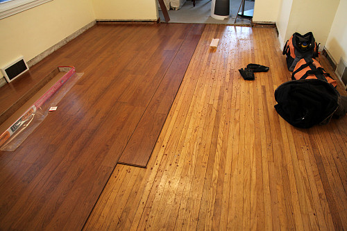 Laminate flooring over wood subfloor by gardener41/flickr