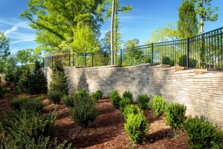 Stone and metal fence / courtesy Belgard