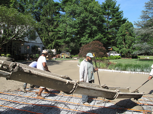 pouring concrete base for brick driveway installation IMG_1512