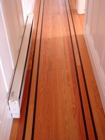 Hallway electric baseboard heater Mike Linksvayer / Public domain