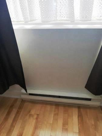Curtains above baseboard heater / Laura Firszt