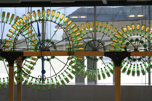 Beer bottle clocks by Stanley Clockworks stand on display at the Philadelphia International Airport. (Photo: waitscm/Flickr)