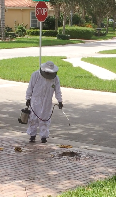 Pest control pro in his astronaut suit