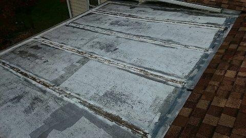 Before: damaged sunroom roof