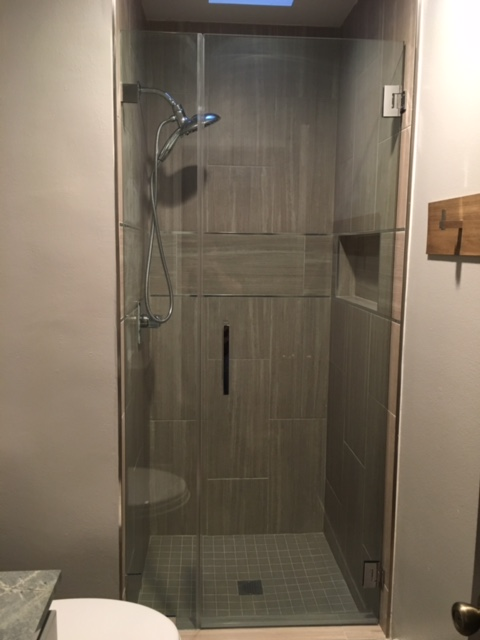 Newly tiled shower for the first bathroom remodel