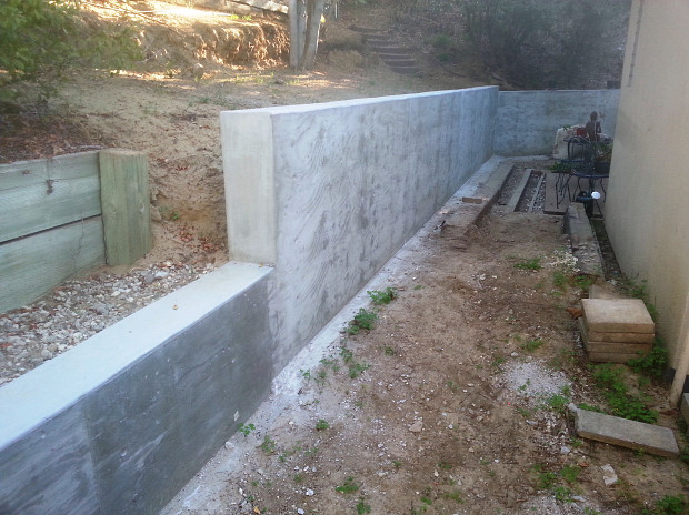 Sturdy concrete wall next to my house
