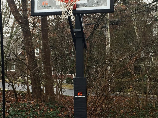 In-ground basketball hoop in the rain