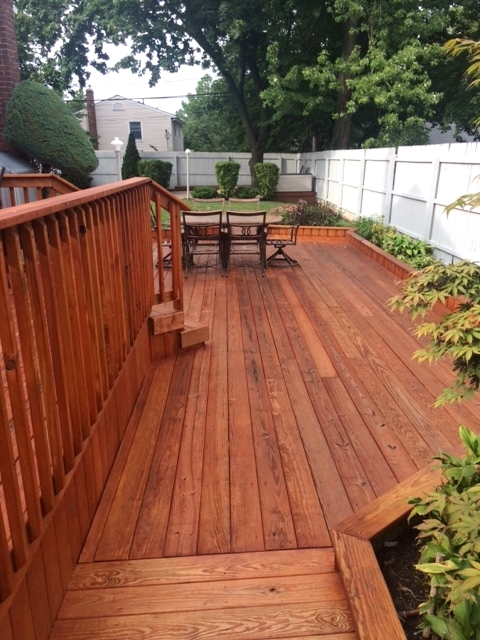 Deck stain is a rich reddish-brown
