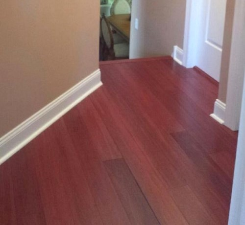 Hardwood floor at head of stairs