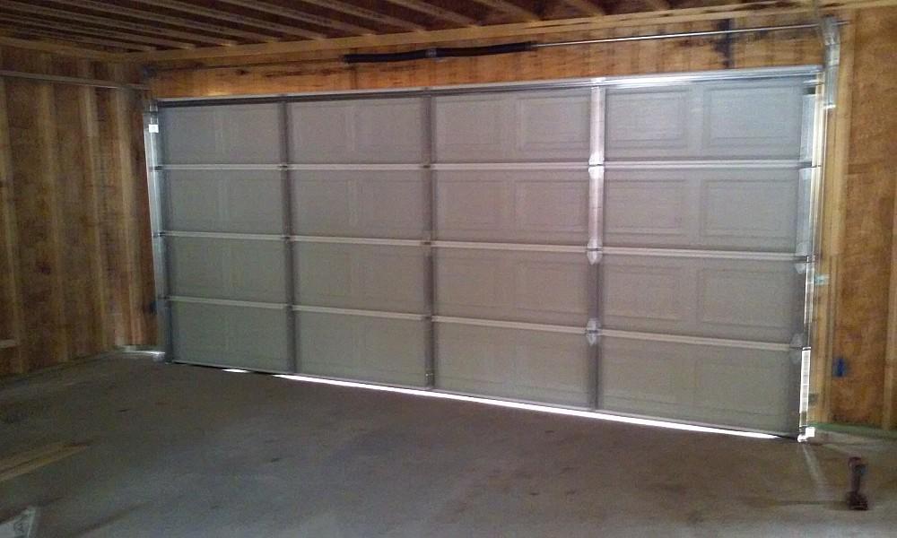 The garage door man networx for Garage man door