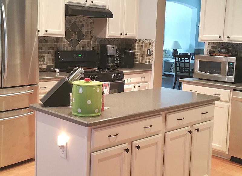 Refinishing the cabinets brightened my kitchen incredibly for Kitchen cabinets repair contractors